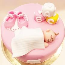 Gâteau baby shower poupon