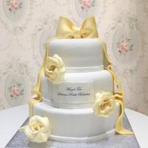 Gâteau Rose et Noeud doré